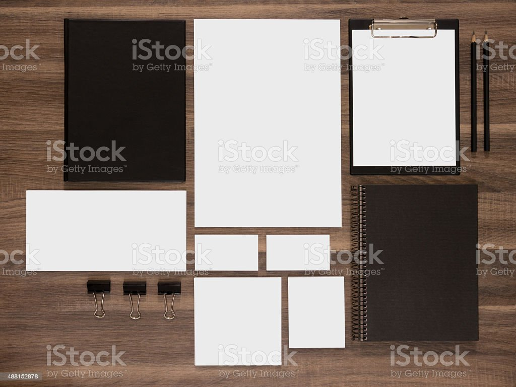 Branding mockup collection on brown wooden desk background. stock photo