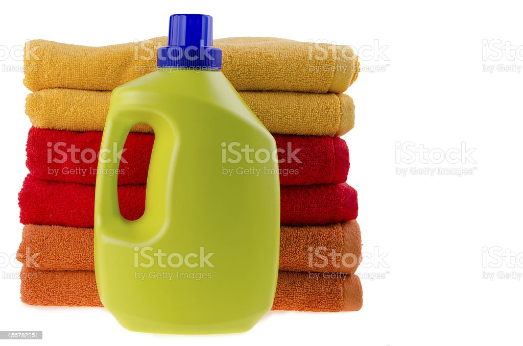 Brandless detergent bottle and pile of towels stock photo