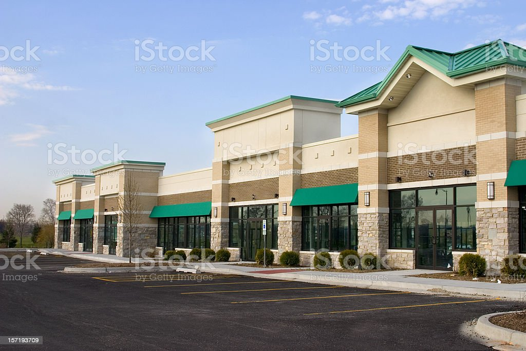 Brand-new strip mall and parking in the suburbs stock photo