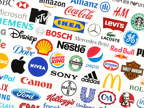 Logotype collection of some of most famous brands in the world on a screen - including Adidas, Nestle, Nike, McDonald's, Sony, Facebook, Ikea, Pepsi and much more printed on quality paper and shot with a high resolution camera.