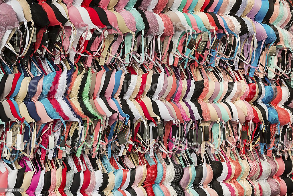 bras hanging on the wall at central market stock photo