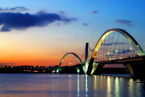 бразилиа's cerrado закат и jk мост - бразилия стоковые фото и изображения