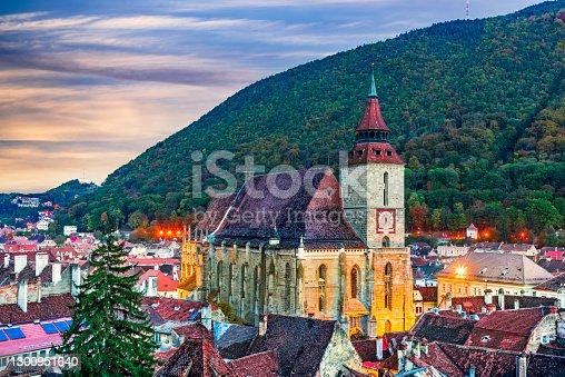 Brasov, Romania. Black Church is famous saxon cathedral in Transylvania, Eastern Europe. Tampa Mountain background.