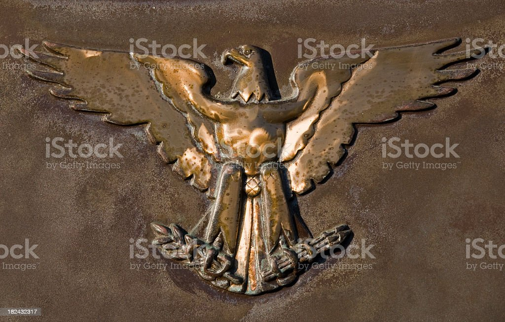 brass American eagle with arrows and claws stock photo