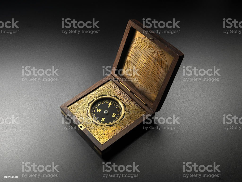 Brass Antique Compass on gray, direction stock photo