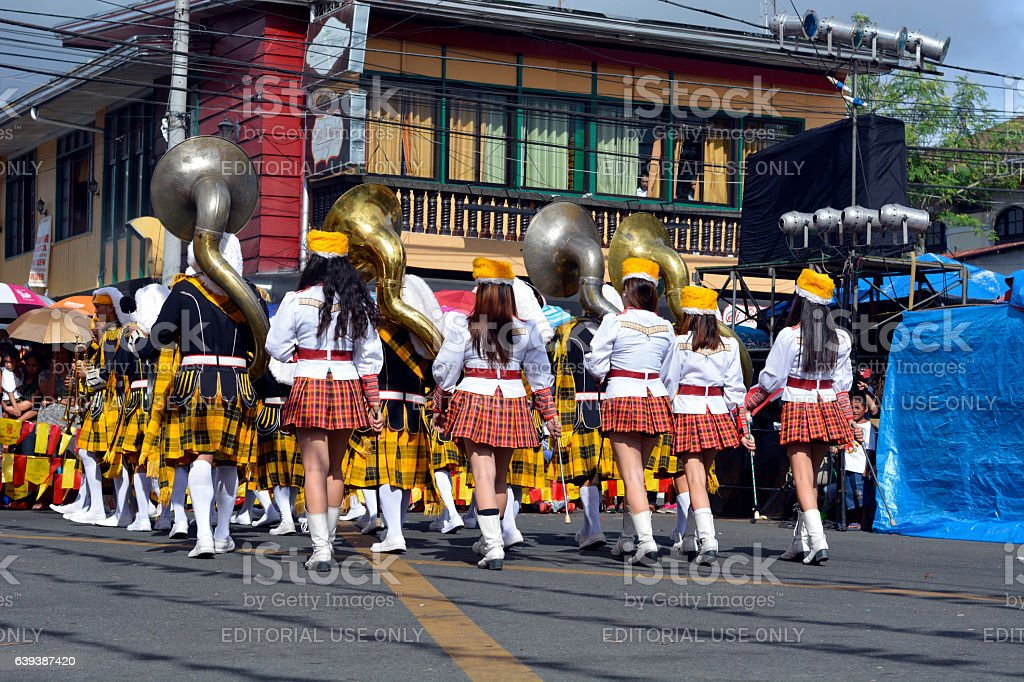 Brass band majorettes synchronized marching in recess stock photo