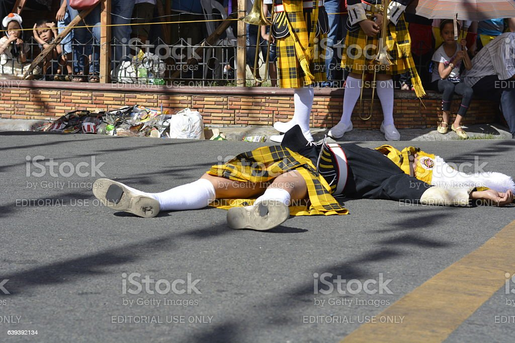 Brass band member fainted on street during performance stock photo