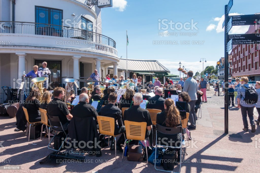 Brass Band Playing Music In Front Of Penarth Pier Stock Photo