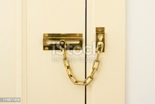 Brass chain door lock showing slight signs of cosmetic wear.