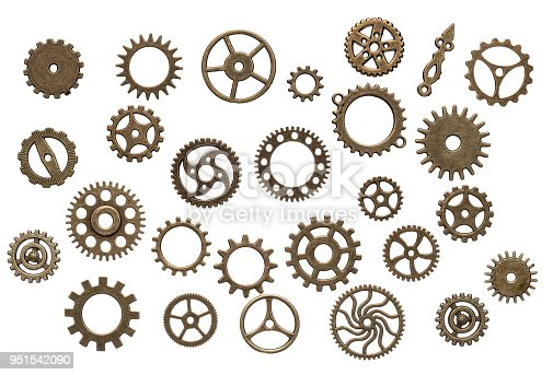 Many old brass, clockwork cog wheels isolated on white background