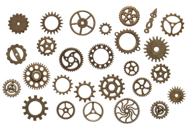 brass cogwheels isolated on white background - cog stock photos and pictures