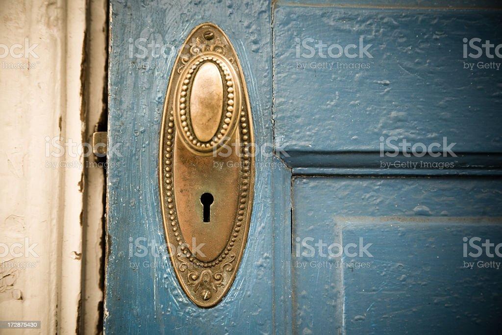 Brass Doorknob on a Blue Door stock photo