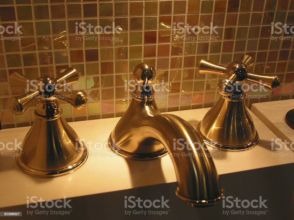Brass faucet bathroom royalty-free stock photo