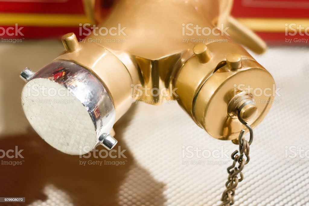 Brass fire valves on a vintage fire truck. Parts of fire engine close- up stock photo