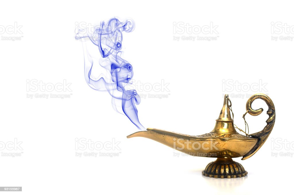 Brass genie lamp emitting blue smoke against white backdrop stock photo