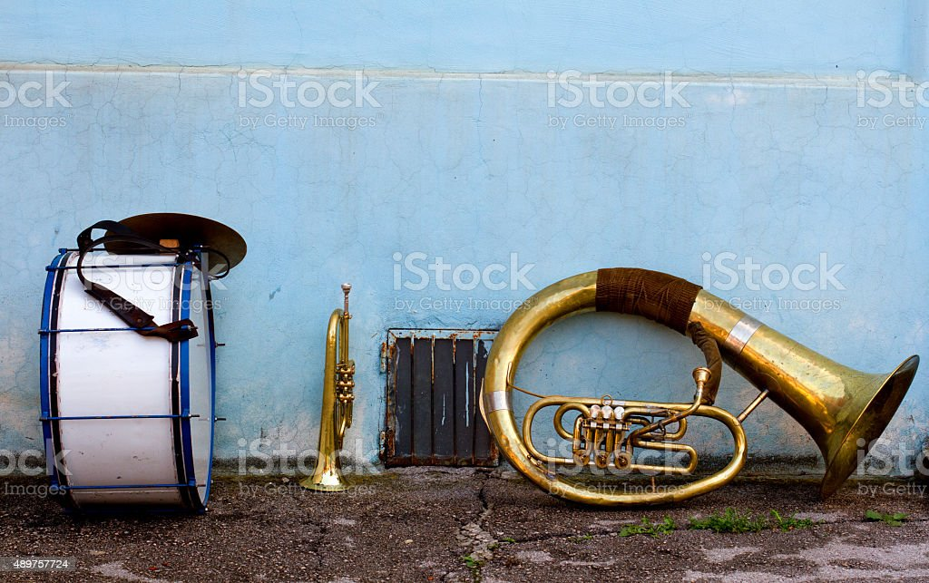 Brass instruments left on the street during a break stock photo