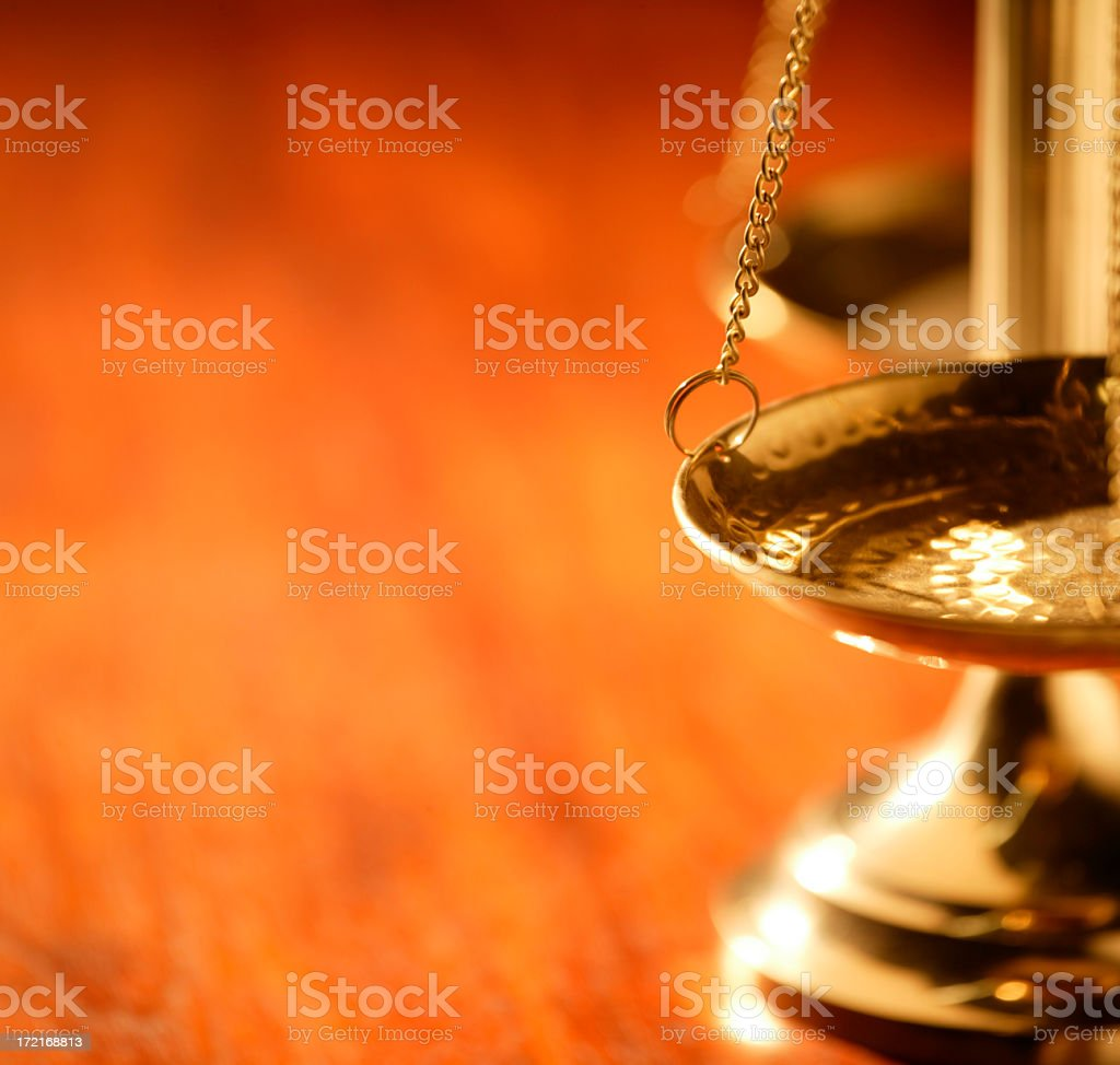 Brass justice scale on warm wooden table stock photo
