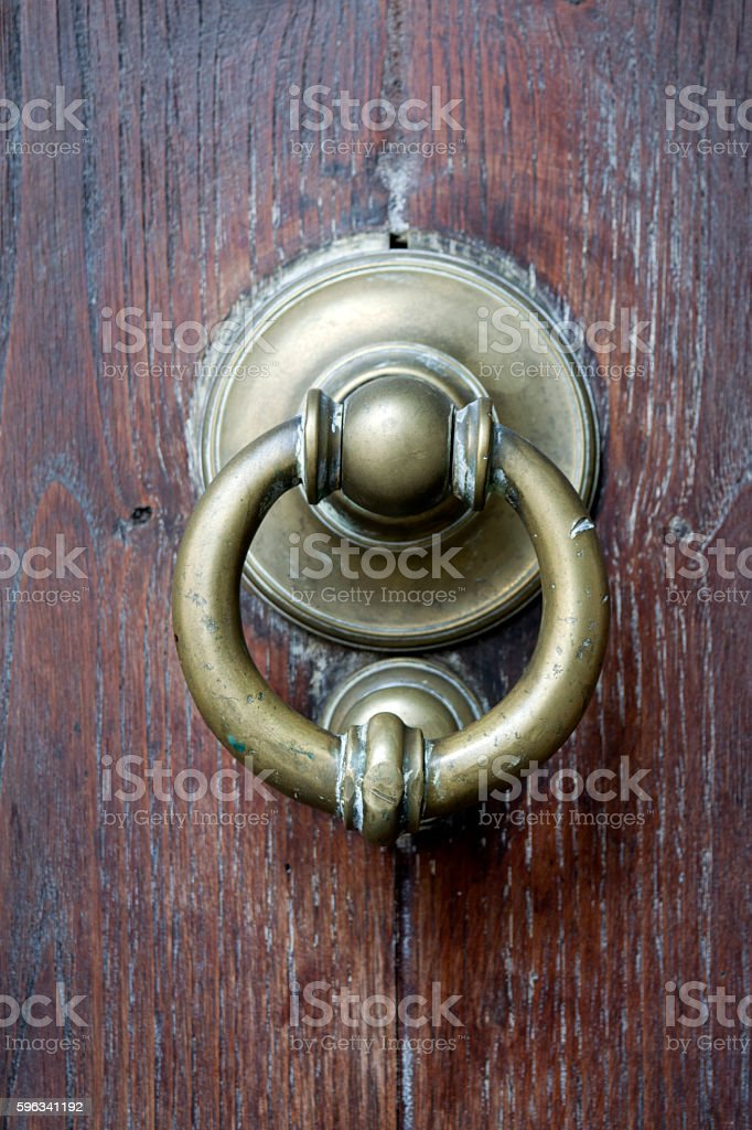 brass knocker on a wooden main door royalty-free stock photo
