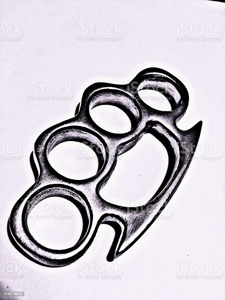 brass knuckles black and white stock photo