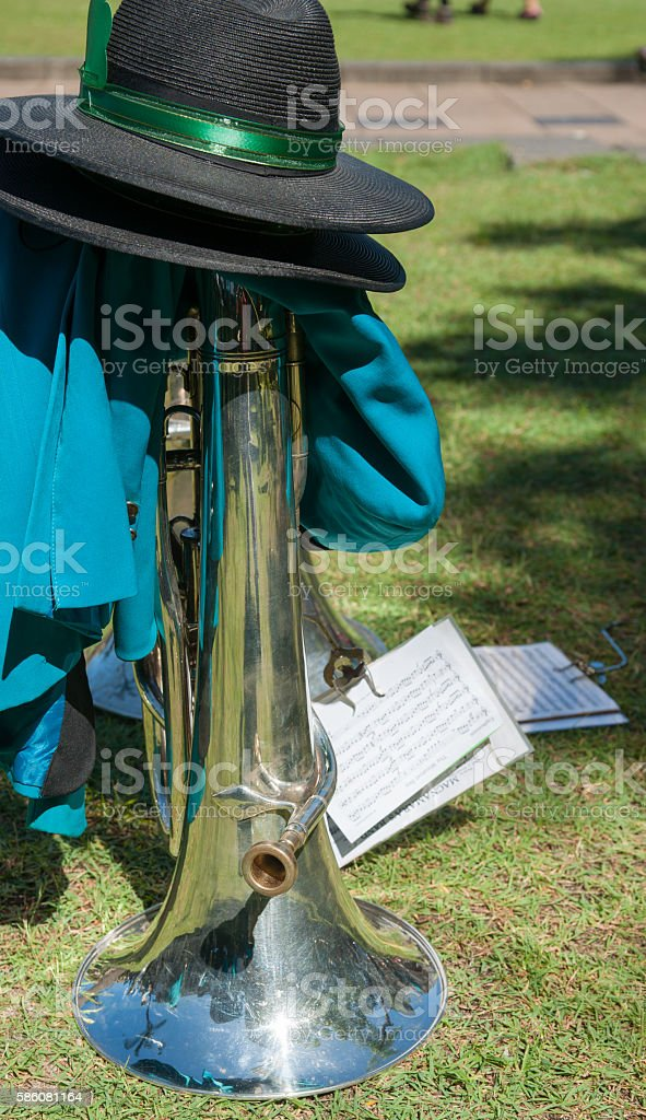 Brass musical instrument put on ground with hat stock photo