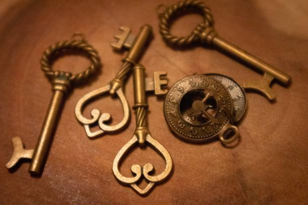 Brass objects keys and compass stock photo