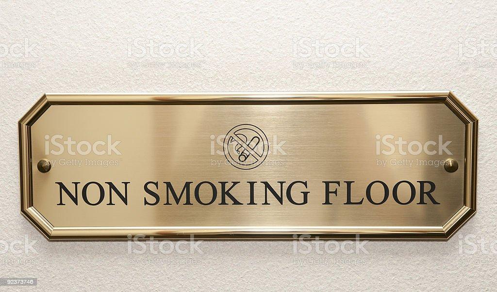 Brass plate restricting smoking on hotel floor stock photo