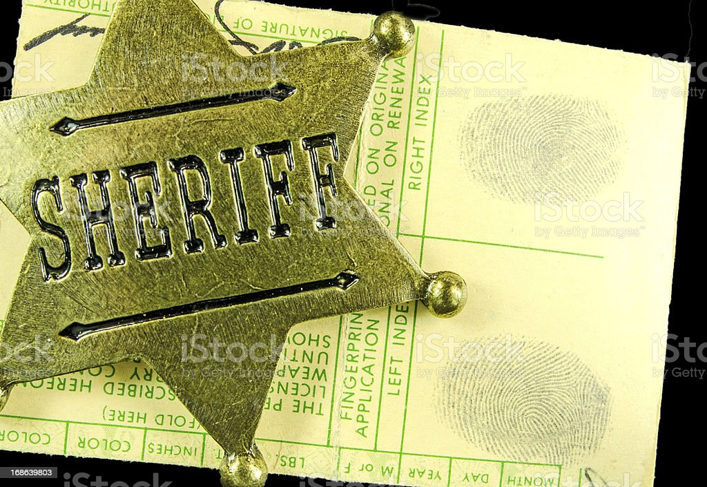 Brass Sheriff Badge and Fingerprints royalty-free stock photo