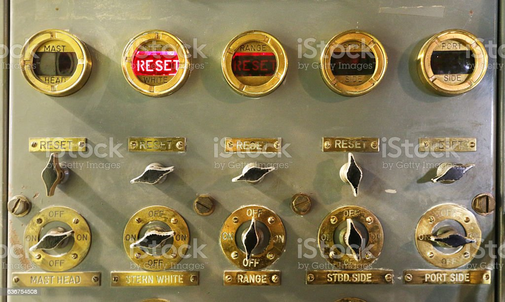 Brass Switches on control panel stock photo
