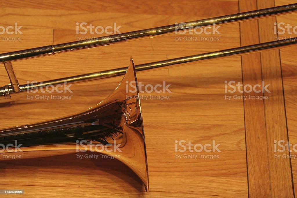 Brass Trombone on Hardwood Floor royalty-free stock photo