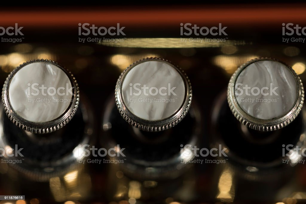 Brass trumpet finger buttons detail closeup stock photo