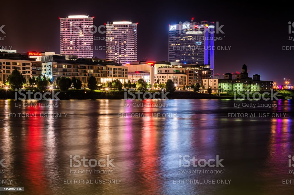 Bratislava at night, with the city lights reflected in the Danube river. royalty-free stock photo