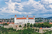Bratislava, Slovakia - May 24, 2018: View of Bratislava castle which occupies a prominent location in the city overlooking the Danube river.