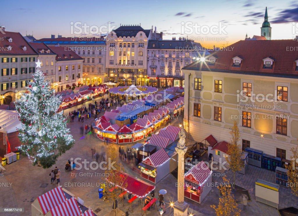 Bratislava - Christmas market on the Main square in evening dusk. stock photo