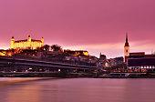 Bratislava cityscape at sunset in dramatic pink sky, Slovakia.