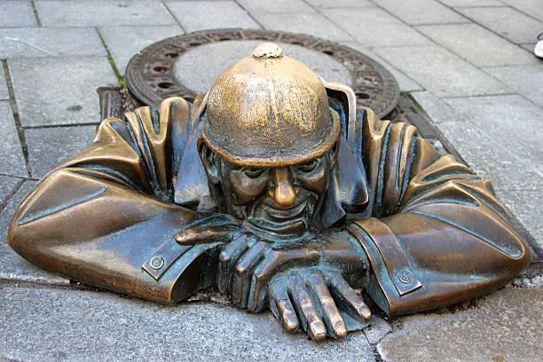 bratislava - man at work statue stock photo
