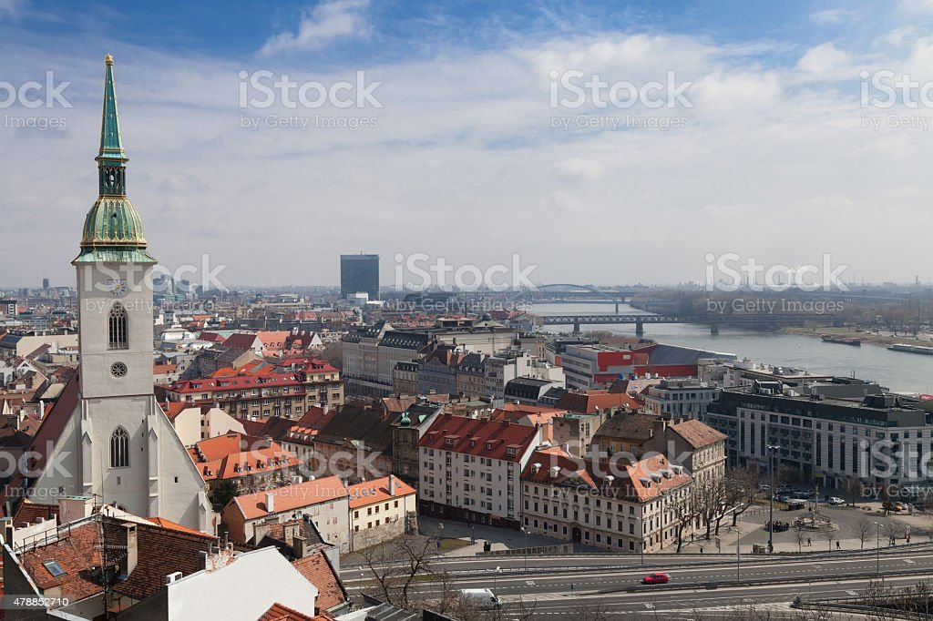 Bratislava roof and medieval church stock photo