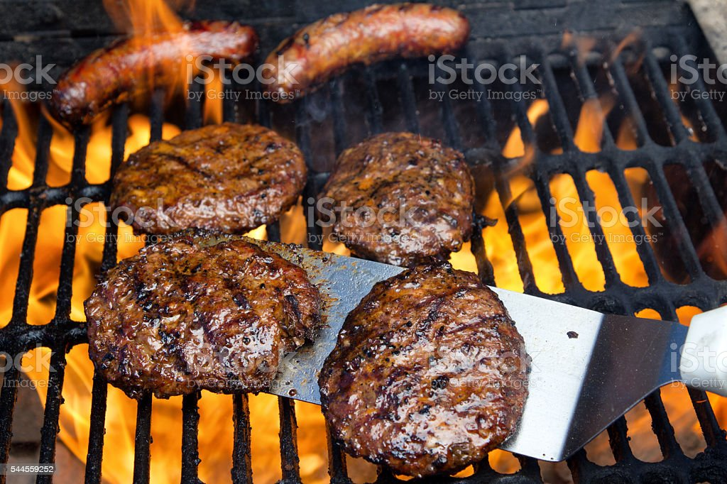 Brats And Burgers Fired To Perfection On An Outdoore Grill stock photo