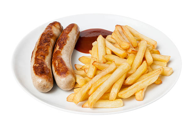Bratwurst and french fries stock photo