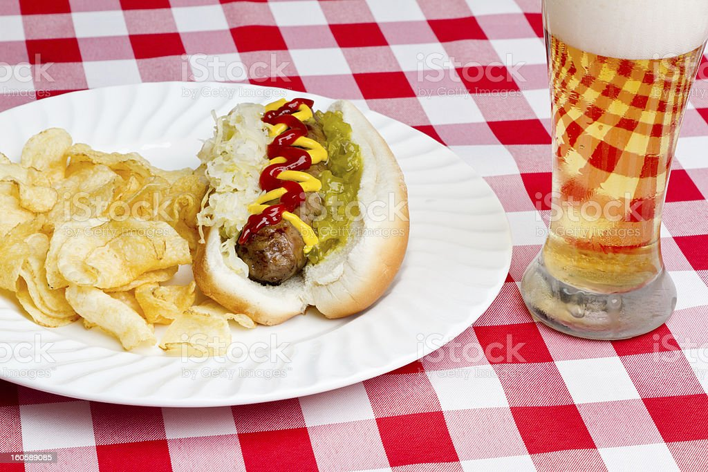 Bratwurst on a Bun with Beer royalty-free stock photo