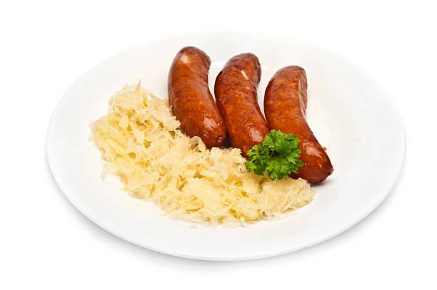 bratwurst - bratwurst mit sauerkraut stock-fotos und bilder