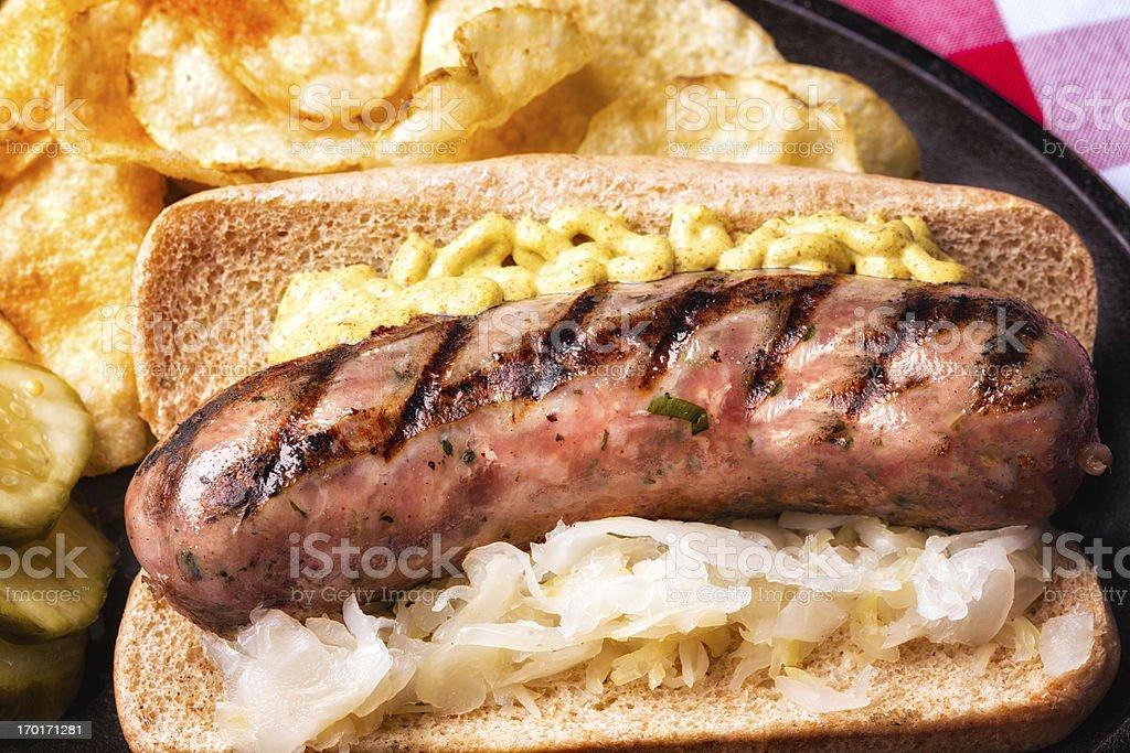 Bratwurst with Mustard and Saurkraut bildbanksfoto
