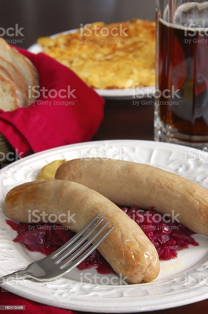 Bratwurst with Red Cabbage and Roeschti royalty-free stock photo