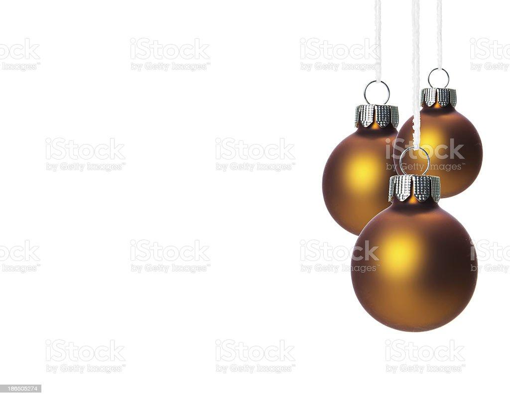 Material Christbaumkugeln.Braune Christbaumkugeln Hangend Freigestellt Stock Photo