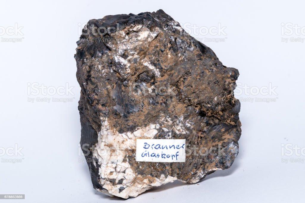 Brauner Glaskopf black gemstone gem jewel mineral precious stone caption stock photo