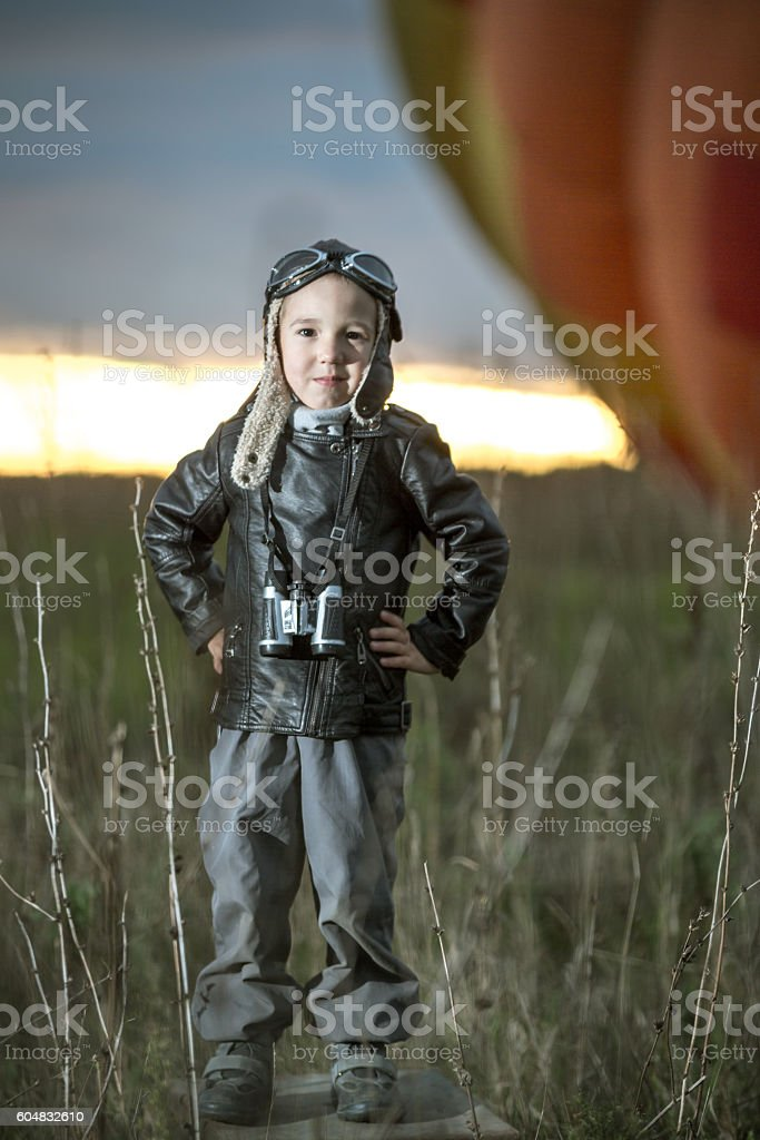 Brave Aviator Boy At Sunset stock photo