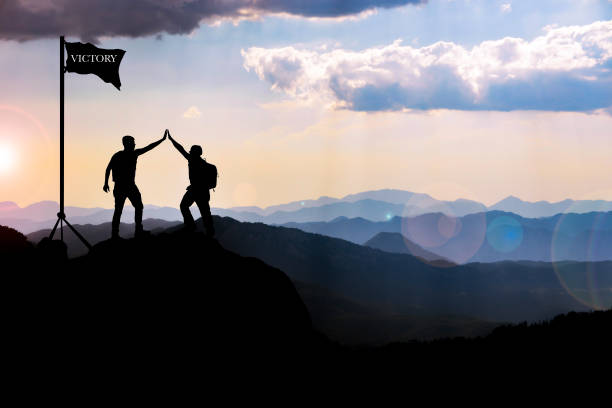 brave climbing of two friends, moments of celebration of their achievements and victories - target australia stock pictures, royalty-free photos & images
