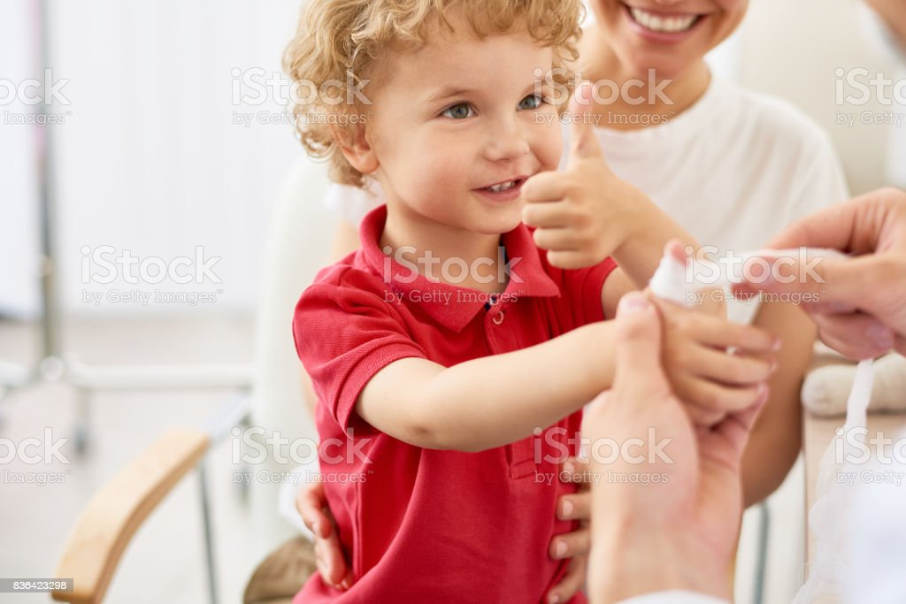Brave Little Boy  in Doctors Office stock photo