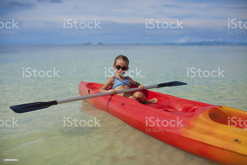 brave little girl floating in kayak on the high seas royalty-free stock photo