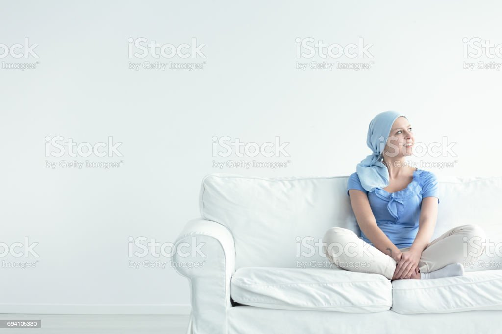 Brave woman during oncology treatment stock photo