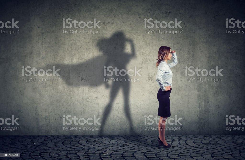 Brave woman posing as super hero royalty-free stock photo